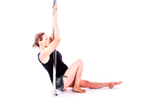 Flying through pregnancy pole dance